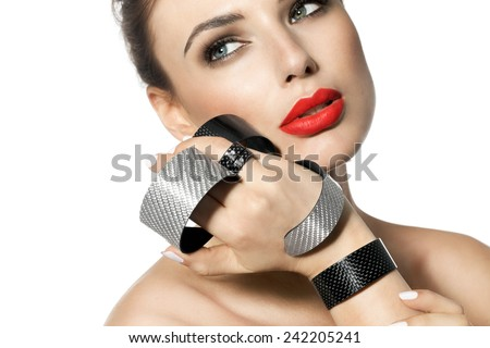 Beautiful woman posing with modern tech jewelry carbon and diamond and wearing red lipstick. - stock photo