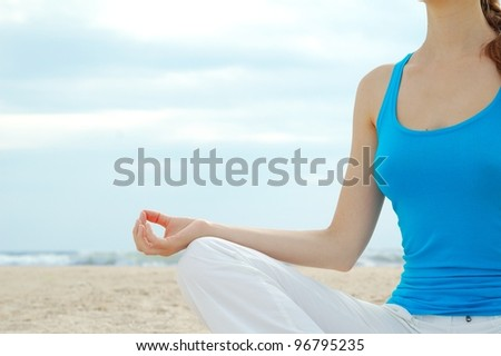Beautiful woman practice yoga on the beach - stock photo