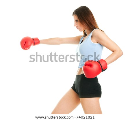 Beautiful woman practicing boxing. Isolated on white - stock photo