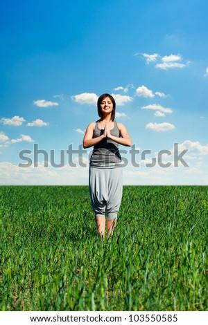 beautiful woman practicing yoga at sunny day - stock photo