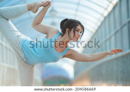Beautiful Woman Practicing Yoga Outside On Bridge, Healthy Lifestyle Wellness Concept - stock photo