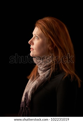 Beautiful woman profile portrait red hair - stock photo