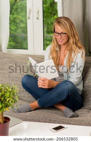 beautiful woman read a book at home
