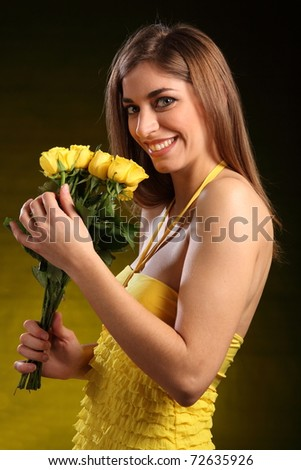 Beautiful woman receives yellow roses - stock photo