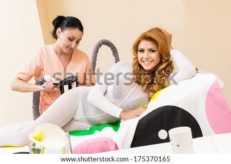beautiful woman receiving a massage trans dermal - stock photo