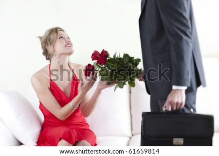 Beautiful woman receiving red roses on Valentine's Day, Birthday or Anniversary - stock photo