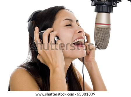 beautiful woman recording vocals in music studio, isolated on white background - stock photo