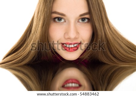 beautiful woman reflection mirror smile isolated - stock photo
