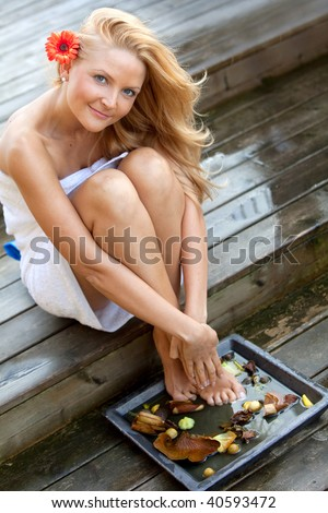 Beautiful woman relaxing at a spa isolated - stock photo