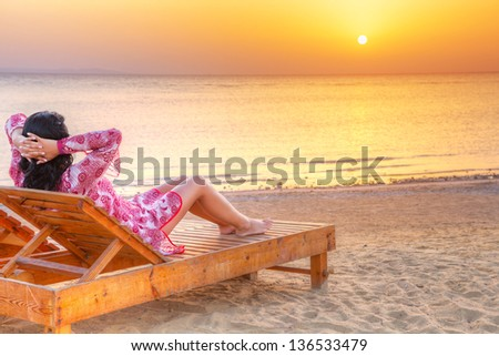 Beautiful woman relaxing at sunrise over Red Sea in Egypt - stock photo
