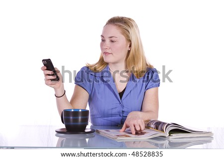 Beautiful Woman Relaxing by Reading a Magazine and Drinking Coffee - stock photo