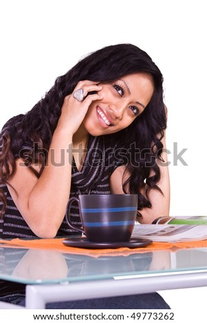 Beautiful Woman Relaxing by Reading a Magazine and Drinking Coffee