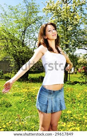 beautiful woman relaxing in garden - stock photo