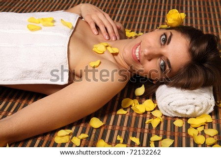 Beautiful woman relaxing in health spa - stock photo