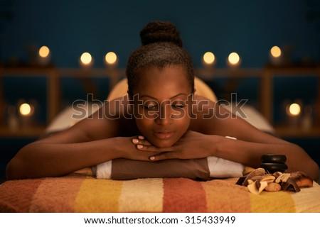 Beautiful woman relaxing in luxury spa salon - stock photo