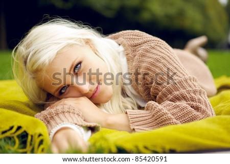 Beautiful woman relaxing in park - stock photo