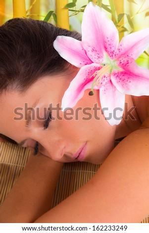 Beautiful woman relaxing in spa - stock photo