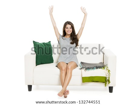 Beautiful woman relaxing on a sofa, isolated over a white background - stock photo