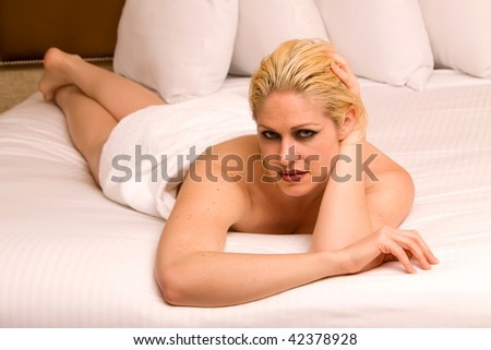 Beautiful woman relaxing on bed
