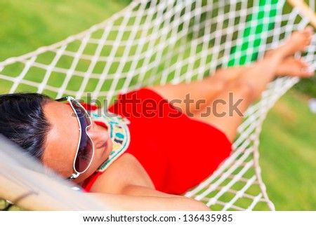 Beautiful woman relaxing on the hammock - stock photo