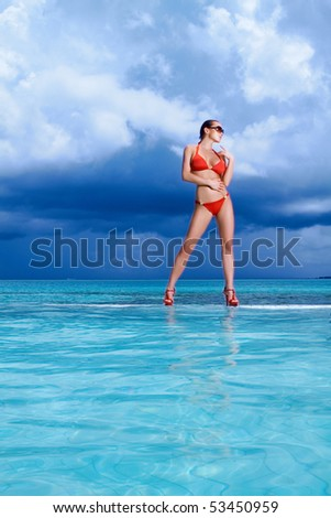 Beautiful woman resting near pool at Maldives