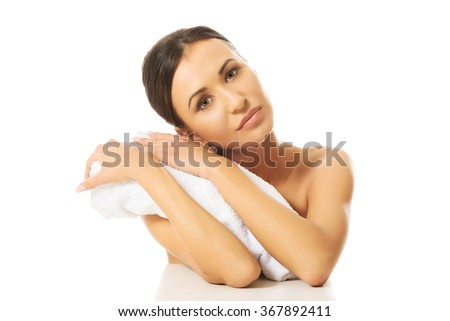 Beautiful woman rests her head on a rolled towel