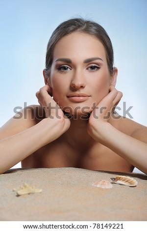 beautiful woman restsng on beach - stock photo