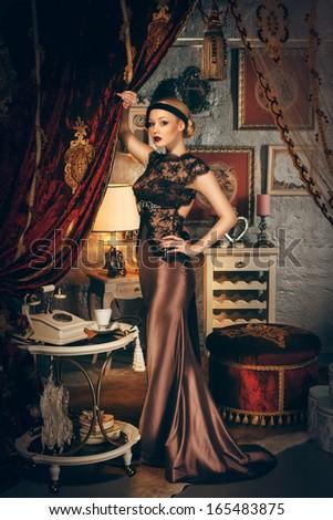 Beautiful woman retro style interior, full length - stock photo