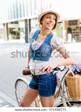 Beautiful woman riding on bike
