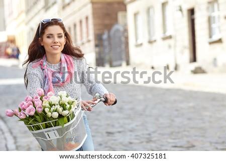 Beautiful woman riding on bike - stock photo