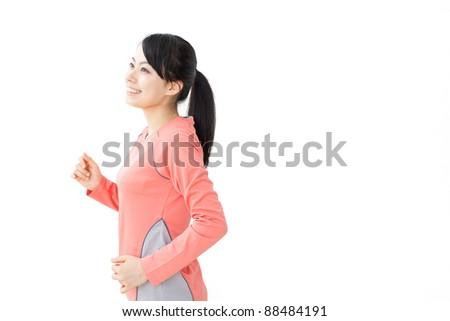 beautiful woman running isolated on white background - stock photo