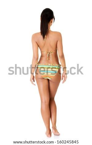 Beautiful woman's back in bikini. Isolated on white.  - stock photo
