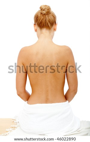 Beautiful woman's back relaxing at a spa - stock photo