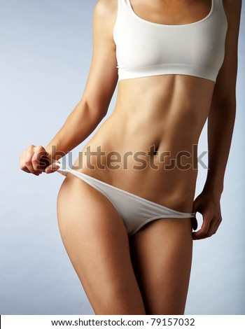 beautiful woman's body is in underwear - stock photo