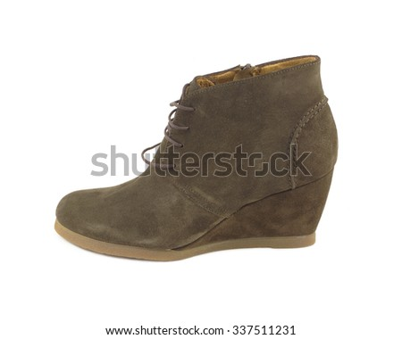 Beautiful woman's brown suede boot isolated on white side view closeup - stock photo