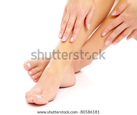 Beautiful woman's crossed legs and hands - stock photo