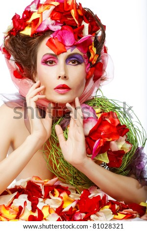 Beautiful Woman's Face and rose petals. Bride make-up.