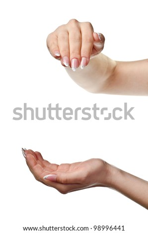 Beautiful woman's hands open. Isolated on white background