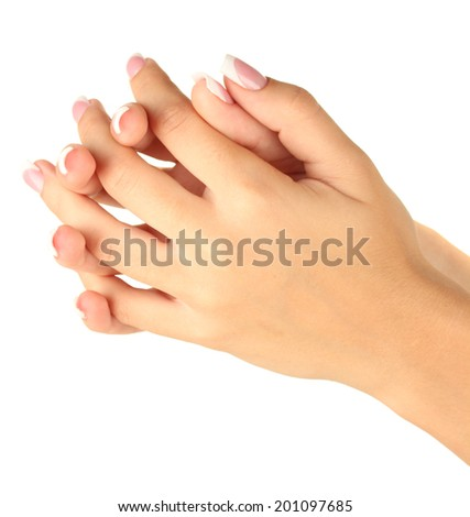 Beautiful woman's hands with french manicure on white background