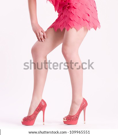 Beautiful woman's legs in fashion shoes on background - stock photo