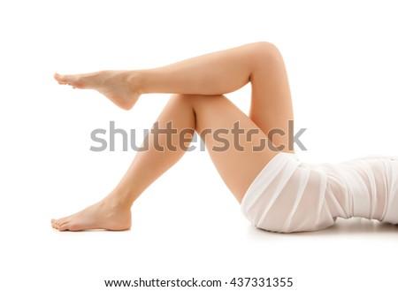 Beautiful woman's legs on white background  - stock photo