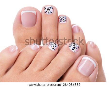 Beautiful woman's nails of legs with beautiful french manicure and art design - stock photo