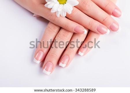 Beautiful woman's nails with beautiful french manicure. - stock photo