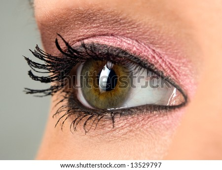 beautiful woman`s open green eye close-up