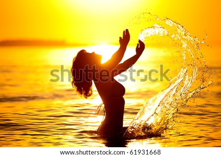 beautiful woman's silhouette in the sea