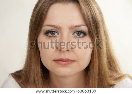 Beautiful woman sad. White background - stock photo