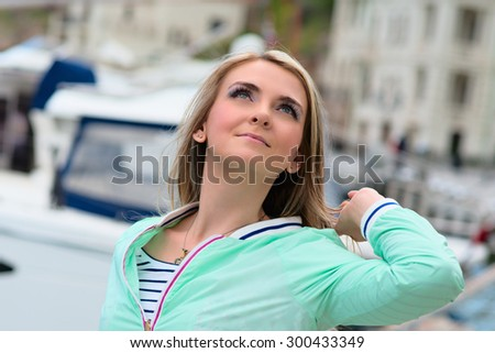 Beautiful woman sailing, young adult lady enjoying summer travel. European girl tourist traveling around the world