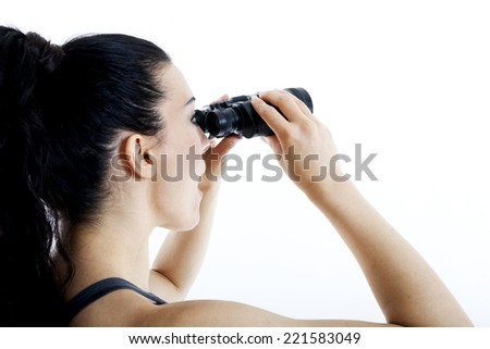 beautiful woman searching with binoculars and looking surprised - stock photo