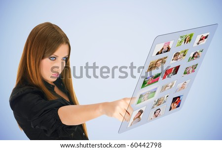 Beautiful woman select virtual friends. - stock photo
