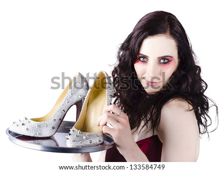 Beautiful woman selling exquisite high heel shoes with spikes on silver service platter - stock photo
